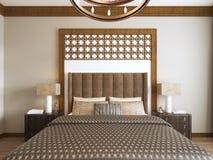Κρεβάτι στο Μεσο-Ανατολικό ύφος με τα ξύλινα χαρασμένα headboard και κρεβατιών αραβικά κλωστοϋφαντουργικά προϊόντα ελεύθερη απεικόνιση δικαιώματος