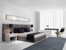 Κρεβατοκάμαρα πολυτέλειας με το γκρίζο κουμπωμένο κρεβάτι Στοκ Φωτογραφίες