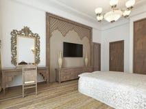 Κρεβατοκάμαρα στο Μεσο-Ανατολικό αραβικό ύφος με τις πολυτελείς ξύλινες γλυπτικές και ένα μεγάλο κρεβάτι με ξύλινο headboard απεικόνιση αποθεμάτων