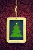 Κρεμασμένη πλάκα Χριστουγέννων Στοκ φωτογραφία με δικαίωμα ελεύθερης χρήσης