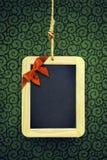 Κρεμασμένη πλάκα Χριστουγέννων Στοκ φωτογραφίες με δικαίωμα ελεύθερης χρήσης