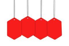 κρεμώντας κόκκινες ετικέ& Στοκ εικόνες με δικαίωμα ελεύθερης χρήσης