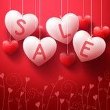 Κρεμώντας μπαλόνια πώλησης καρδιών για την προώθηση ημέρας βαλεντίνων Στοκ Εικόνες