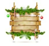 Κρεμώντας ξύλινος πίνακας διαφημίσεων Χριστουγέννων Στοκ φωτογραφία με δικαίωμα ελεύθερης χρήσης