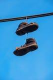 κρεμώντας παπούτσια Στοκ Φωτογραφία