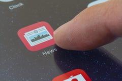Κρότος του app ειδήσεων εικονιδίου σε ένα iPhone Στοκ φωτογραφία με δικαίωμα ελεύθερης χρήσης