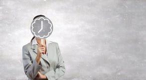Κρύβοντας πρόσωπο επιχειρηματιών πίσω από τη μάσκα Στοκ Φωτογραφία