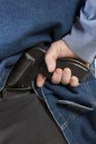 Κρύβοντας πυροβόλο όπλο Στοκ Εικόνες