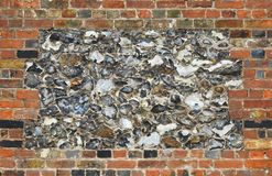 Κτήριο υποβάθρου τούβλων πλινθοδομής τοίχων πετρών πυρόλιθου στοκ εικόνα