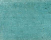 Κυανό κλωστοϋφαντουργικό προϊόν χρώματος surfacr με τα σημεία και τις γρατσουνιές Στοκ Φωτογραφίες