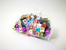 κυβικό αλφάβητο στο πλαστικό στοκ φωτογραφία