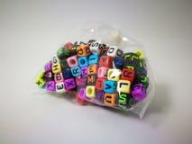 κυβικό αλφάβητο στο πλαστικό στοκ φωτογραφία με δικαίωμα ελεύθερης χρήσης