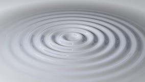 Κυκλικά κύματα σε ένα άσπρο υγρό