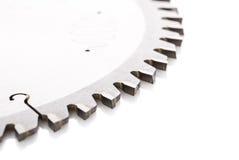 Κυκλικά πριόνια με την κινηματογράφηση σε πρώτο πλάνο δοντιών, σε ένα λευκό Στοκ Εικόνες