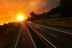 Κυκλοφορία εθνικών οδών ηλιοβασιλέματος στοκ εικόνες με δικαίωμα ελεύθερης χρήσης