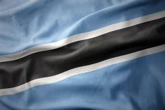 Κυματίζοντας ζωηρόχρωμη σημαία της Μποτσουάνα Στοκ Εικόνα
