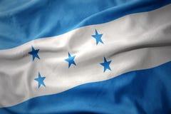 Κυματίζοντας ζωηρόχρωμη σημαία της Ονδούρας στοκ εικόνα με δικαίωμα ελεύθερης χρήσης