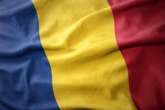 Κυματίζοντας ζωηρόχρωμη σημαία της Ρουμανίας Στοκ εικόνα με δικαίωμα ελεύθερης χρήσης