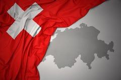 Κυματίζοντας ζωηρόχρωμοι εθνική σημαία και χάρτης της Ελβετίας Στοκ Φωτογραφίες