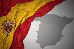 Κυματίζοντας ζωηρόχρωμοι εθνική σημαία και χάρτης της Ισπανίας Στοκ φωτογραφία με δικαίωμα ελεύθερης χρήσης