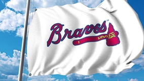 Κυματίζοντας σημαία με το επαγγελματικό λογότυπο ομάδων των Atlanta Braves Εκδοτική τρισδιάστατη απόδοση Στοκ Εικόνες