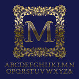 Κυματιστές ριγωτές χρυσές επιστολές και αρχικό μονόγραμμα στο τετραγωνικό πλαίσιο Στοκ εικόνες με δικαίωμα ελεύθερης χρήσης