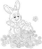 Κυνήγι αυγών Πάσχας στα λουλούδια Στοκ Εικόνες