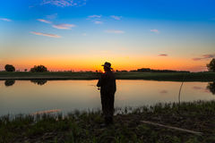 Κυνηγός λούτσων στον ποταμό Στοκ φωτογραφία με δικαίωμα ελεύθερης χρήσης