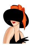 Κυρία σε ένα καπέλο με ένα κόκκινο τόξο Στοκ Φωτογραφία