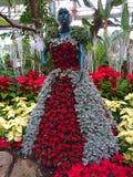Κυρία στα λουλούδια στοκ φωτογραφία