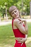Κυρία στο κόκκινο φόρεμα Στοκ Φωτογραφία