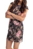 Κυρία στο μαύρο floral φόρεμα Στοκ Φωτογραφίες