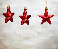 κόκκινα αστέρια Χριστου&gamm Στοκ Φωτογραφίες