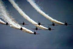 Κόκκινα βέλη RAF Fairford στη δερματοστιξία αέρα Στοκ Εικόνα