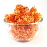Κόκκινα γλυκά τριζάτα νουντλς σε ένα χτύπημα γυαλιού Στοκ Εικόνες