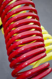 Κόκκινα και κίτρινα κουλουριασμένα καλώδια Στοκ Εικόνες