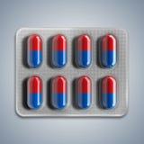 Κόκκινα και μπλε χάπια σε μια φουσκάλα στο γκρίζο υπόβαθρο Στοκ Εικόνα