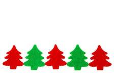 Κόκκινα και πράσινα χριστουγεννιάτικα δέντρα με το διάστημα αντιγράφων Στοκ φωτογραφία με δικαίωμα ελεύθερης χρήσης