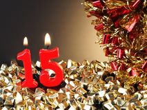 Κόκκινα κεριά που παρουσιάζουν Nr 15 Στοκ Εικόνες