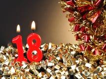 Κόκκινα κεριά που παρουσιάζουν Nr 18 Στοκ Εικόνες