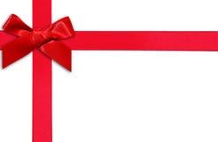 Κόκκινα κορδέλλα και τόξο δώρων στοκ εικόνες