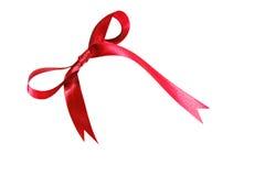 Κόκκινα κορδέλλα και τόξο υφάσματος που απομονώνονται σε ένα άσπρο υπόβαθρο στοκ φωτογραφίες