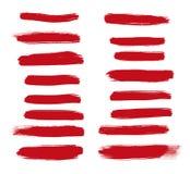 Κόκκινα κτυπήματα βουρτσών που απομονώνονται σε ένα άσπρο υπόβαθρο Στοκ εικόνα με δικαίωμα ελεύθερης χρήσης