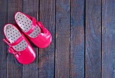 κόκκινα παπούτσια μωρών Στοκ εικόνα με δικαίωμα ελεύθερης χρήσης