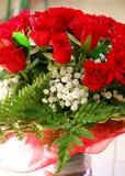 κόκκινα τριαντάφυλλα ανθοδεσμών Στοκ Φωτογραφία