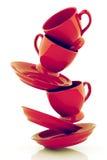 Κόκκινα φλυτζάνια καφέ με τα πιατάκια Στοκ φωτογραφία με δικαίωμα ελεύθερης χρήσης