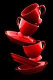 Κόκκινα φλυτζάνια καφέ με τα πιατάκια Στοκ εικόνα με δικαίωμα ελεύθερης χρήσης