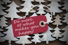 Κόκκινα Christmas Label Do More What σας κάνει ευτυχησμένους Στοκ φωτογραφίες με δικαίωμα ελεύθερης χρήσης