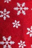 κόκκινα snowflakes Χριστουγέννων ανασκόπησης Στοκ Φωτογραφίες