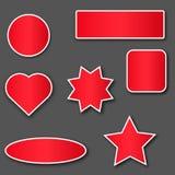 κόκκινες αυτοκόλλητες ετικέττες με το άσπρο κτύπημα Στοκ φωτογραφία με δικαίωμα ελεύθερης χρήσης